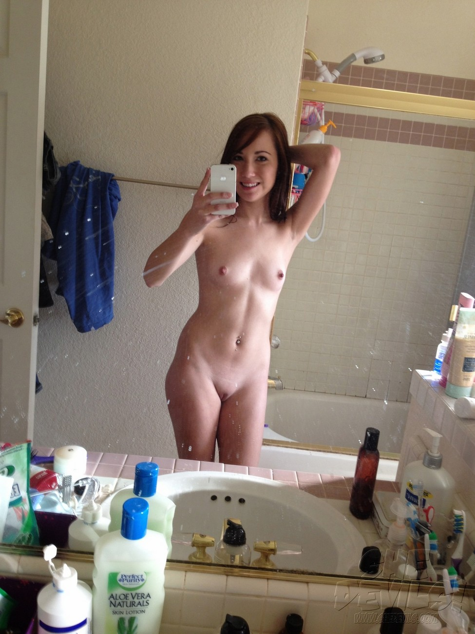 Young female taking selfphotos naked